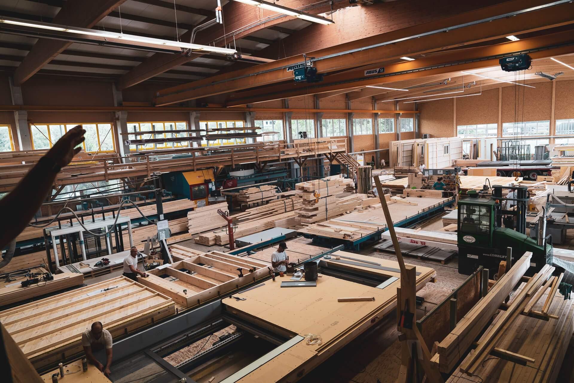 Burkart Haus JANS holzbau building partner wood workshop construction detached houses module production team